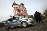 Policemen stand in front of the bishop's house near the cathedral on October 13, 2013 in Limburg an der Lahn, western Germany