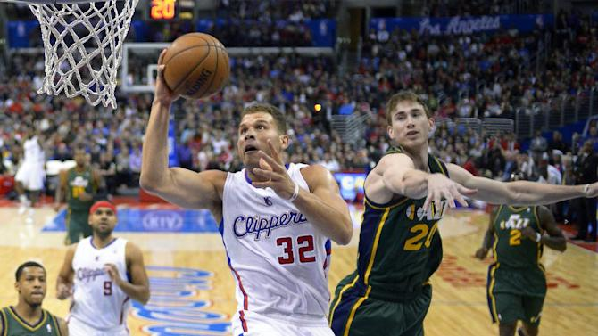 Los Angeles Clippers forward Blake Griffin, center, puts up a shot as Utah Jazz guard Gordon Hayward defends during the first half of an NBA basketball game, Saturday, Dec. 28, 2013, in Los Angeles