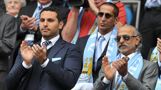 Manchester City's Chairman Khaldoon Al Mubarak (L) Applauds   RESTRICTED TO EDITORIAL USE. No Use With Unauthorized AFP/Getty Images