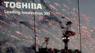 The Toshiba logo outside a shop in Tokyo. Japan's Toshiba said Tuesday its full-year net profit dropped by almost half to $921 million on a strong yen, weak digital product sales, and last year's natural disasters in Japan and Thailand