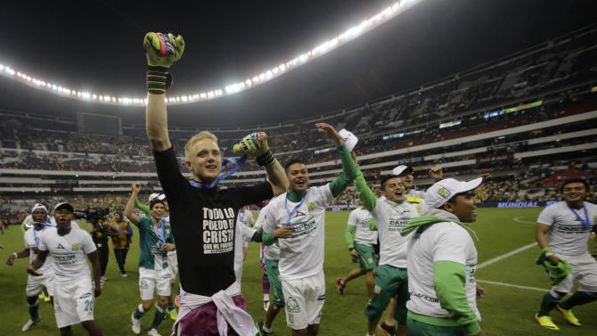 Leon's goalkeeper Yarbrough celebrates with his teammates after winning the Mexican league championship final soccer match against America at the Azteca stadium in Mexico City