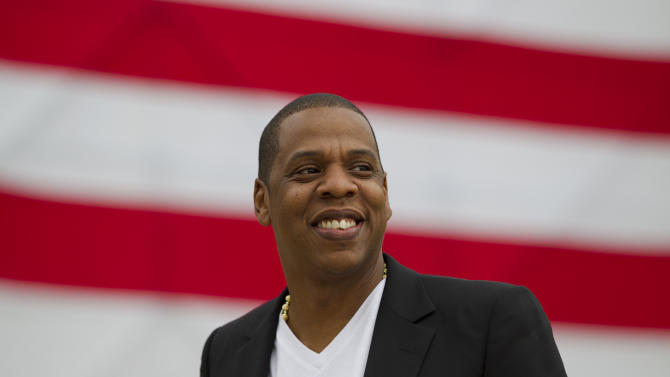 "Entertainer Shawn ""Jay-Z"" Carter smiles in between interviews, after a news conference at Philadelphia Museum of Art, Monday, May 14, 2012, in Philadelphia. The rapper announced plans for a two-day music festival in Philadelphia's at Fairmount Park, featuring nearly 30 acts ""that embody the American spirit"" on Labor Day weekend, Sept. 1 and Sept. 2, 2012. (AP Photo/Matt Rourke)"