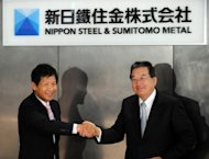Shoji Muneoka (R), chairman and CEO of Nippon Steel and Sumitomo Metal, and president Hiroshi Tomono unveil the company's plaque in Tokyo on October 1. Two of Japan's biggest steelmakers merged and created the world's second largest firm in the sector as they look to outpace their Chinese and South Korean rivals