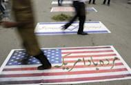 Pakistani demonstrators walk over US and Israeli flags in Islamabad, as they attempt to reach the US embassy during a demonstration against an anti-Islam film. The alleged maker of a provocative anti-Islamic movie that has sparking violence across the Muslim world has been taken for questioning to a police station, local television reported.