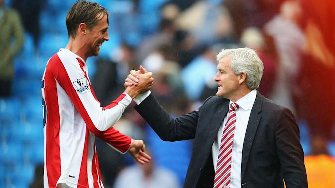 Peter Crouch in Contention to Start Against Everton Says Mark Hughes
