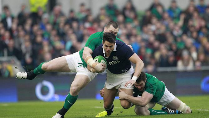 Scotland's Sean Maitland, centre, is tackled by Ireland's Cian Healy, left, and Peter O'Mahony during their Six Nations Rugby Union international match at the Aviva Stadium, Dublin, Ireland, Sunday, Feb. 2, 2014. (AP Photo/Peter Morrison)