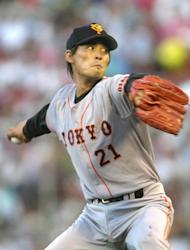 This file photo, taken in August 2000, shows South Korean baseball player Cho Sung-Min playing as a pitcher for Japanese baseball team, the Yomiuri Giants, in Hiroshima. Cho has been found dead at his home in Seoul in an apparent suicide