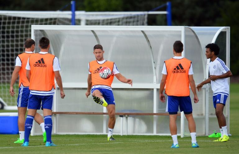 Chelsea's English defender Gary Cahill (C) kicks a football during a team training session at Chelsea's training ground in Stoke D'Abernon, south of London, on July 31, 2015