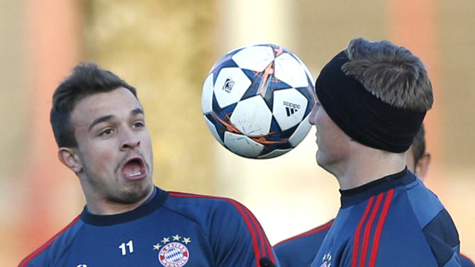 Bayern's Xherdan Shaqiri of Switzerland, left, and Bastian Schweinsteiger challenge for the ball during a training session in Munich, southern Germany, Monday, March 10, 2014, ahead of their round of 16 second leg Champions League soccer match against Arsenal London on Wednesday
