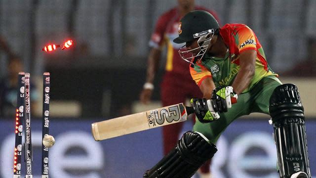 Cricket - West Indies crush Bangladesh to revive semi-final hopes