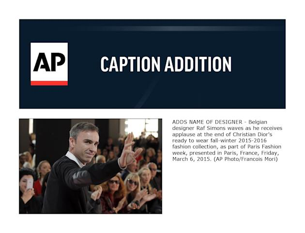 ADDS NAME OF DESIGNER - Belgian designer Raf Simons waves as he receives applause at the end of Christian Dior's ready to wear fall-winter 2015-2016 fashion collection, as part of Paris Fashion we