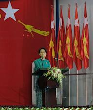 "Aung San Suu Kyi delivers a speech during the National League for Democracy party conference, in Yangon, on March 9, 2013. Suu Kyi urged a revival of the ""spirit of fraternity"" which saw the party build a huge base during iron-fisted junta rule"