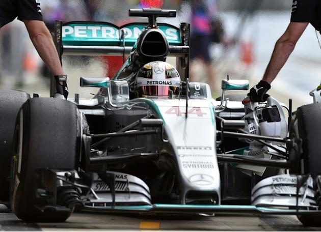Mercedes AMG Petronas F1 Team's British driver Lewis Hamilton arrives in the pits during the second practice session at the Silverstone circuit in Silverstone on July 2, 2015 ahead of the British