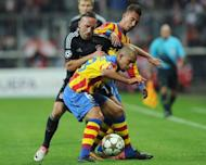 Bayern Munich's midfielder Franck Ribery (L) is caught between Valencia's midfielders David Albelda and Jonas during their UEFA Champions League group F football match in the southern German city of Munich. Bayern won 2-1