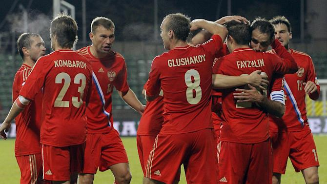 Russia's team, celebrates after Victor Fayzulin scored,  during the World Cup 2014 Group F qualifying soccer match against Luxembourg, in Luxembourg city, at the Josy Barthel stadium, Friday, Oct. 11, 2013