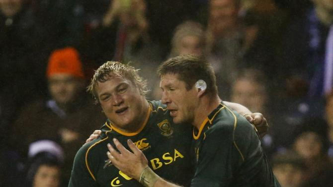 South Africa's Coenie Oosthuizen is congratulated on scoring a try against Scotland by Bakkies Botha during their rugby union match at Murrayfield Stadium in Edinburgh