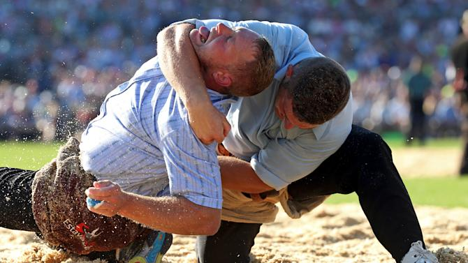Swiss Alpine wrestlers Ulrich and Kaeser fight during the Federal Alpine Wrestling Festival in Estavayer-le-Lac