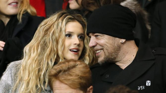 French singer Pascal Obispo and Julie Hantson attend the French Ligue 1 soccer match between Paris St Germain and St Etienne at the Parc des Princes Stadium in Paris