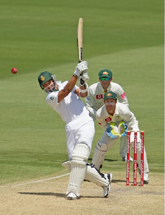 ADELAIDE, AUSTRALIA - NOVEMBER 23:  Alviro Petersen of South Africa hits a boundary as Michael Clarke and Matthew Wade of Australia look on during day two of the Second Test match between Australia an