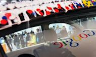 Google logo is reflected in a window of a car in 2010. The state of Nevada has issued a license plate giving Google's self-driving car the green light to travel along public roads