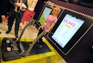 An instructor uses The Fitbug pedometer - a system uplinked to a web site to track your walking steps, distance, diet and fitness activities, at the Las Vegas Convention Center, on January 9, 2013, in Las Vegas, Nevada. CES, the world's largest annual consumer technology trade show, runs from January 8-11 and is expected to feature 3,100 exhibitors showing off their latest products and services