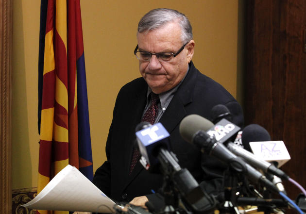 Maricopa County Sheriff Joe Arpaio, arrives to answer questions regarding the Department of Justice announcing a federal civil lawsuit against Sheriff Arpaio and his department, prior to a news confer