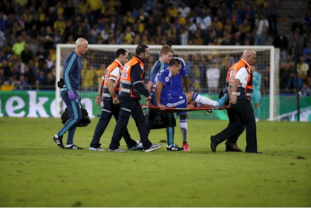 Chelsea's captain John Terry is taken off the pitch on a stretcher during the Champions League Group G soccer match against Maccabi Tel Aviv at Sammy Ofer stadium in Haifa