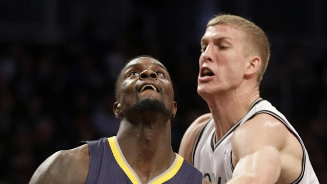 Brooklyn Nets' Mason Plumlee, right, fouls Indiana Pacers' Lance Stephenson during the first half of an NBA basketball game Monday, Dec. 23, 2013 in New York