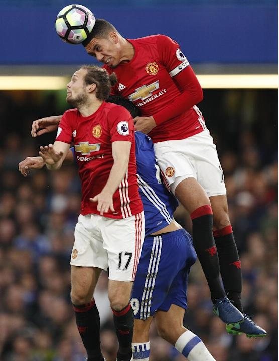 Chelsea's Diego Costa in action with Manchester United's Chris Smalling and Daley Blind