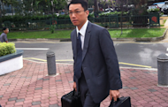 Tey Tsun Hang arrives at the subcourts for the second day of his trial in a sex-for-grades case. (Yahoo! photo)