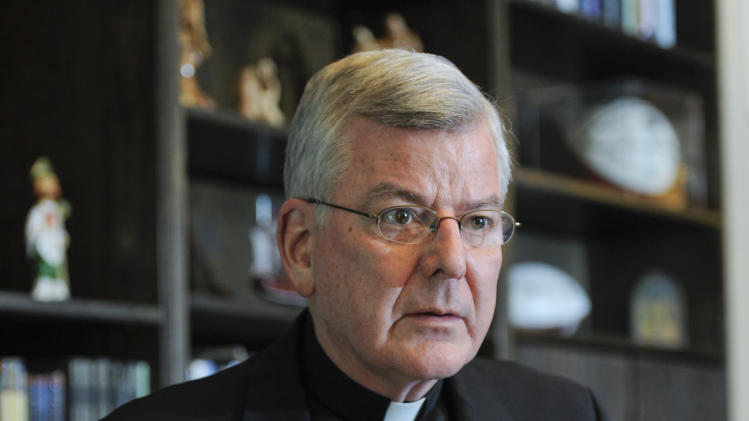 , July 30, 2014. Archbishop Nienstedt met with reporters after a law