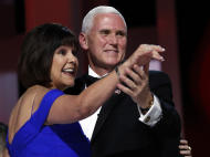 FILE - In this Jan. 20, 2017, file photo, Vice President Mike Pence dances with his wife Karen at the Liberty Ball in Washington. Karen Pence wants people to know that art therapy isn't exactly arts and crafts. The wife of Vice President Mike Pence has been a passionate advocate of art therapy for many years, including during her recent stint as first lady of Indiana. Now, she hopes to use her new and loftier public profile to raise awareness of the mental health profession and help change the public's perceptions about what art therapists actually do. (AP Photo/Alex Brandon, File)