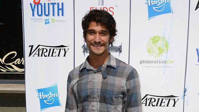 """Tyler Posey arrives at the 7th Annual """"Power of Youth"""" event on the Universal back lot on Saturday, July 27, 2013 in Universal City, Calif. (Photo by Jordan Strauss/Invision/AP)"""