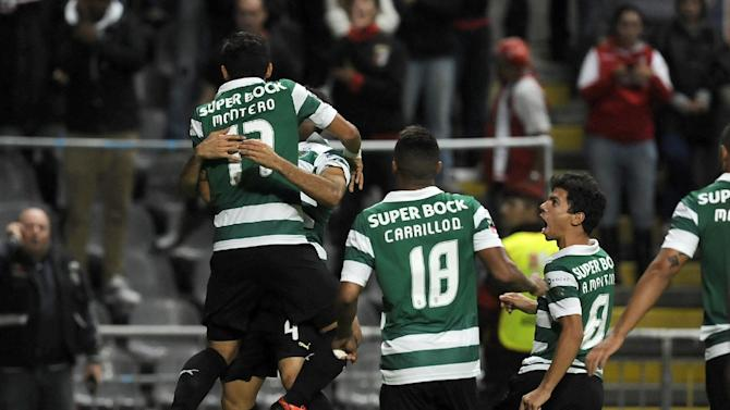Sporting's Fredy Montero, left, from Colombia, celebrates with teammates after scoring against Sporting Braga during their Portuguese League soccer match at the Municipal Stadium, in Braga, Portugal, Saturday Sept.. 26, 2013
