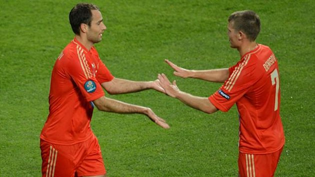 Russian forward Aleksander Kerzhakov (L) celebrates with Russian midfielder Igor Denisov