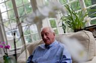 British 1948 Olympian Lionel Price is pictured at his home in London, on July 31, 2012. Price, 85, is the last surviving member of Great Britain's 1948 Olympic basketball team