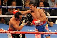 LAS VEGAS, NV - NOVEMBER 12: (R-L) Manny Pacquiao throws a right to the head of Juan Manuel Marquez during the WBO world welterweight title fight at the MGM Grand Garden Arena on November 12, 2011 in Las Vegas, Nevada. (Photo by Ethan Miller/Getty Images)