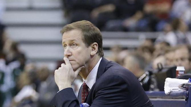 Portland Trail Blazers coach Terry Stotts watches during the first quarter of an NBA preseason basketball game against the Utah Jazz on Wednesday, Oct. 16, 2013, in Salt Lake City