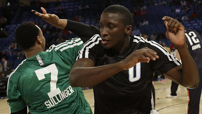 Team Webber's Jared Sullinger of the Boston Celtics, left, dances with Team Webber's Victor Oladipo of the Orlando Magic (0) before the Rising Star NBA All Star Challenge Basketball game, Friday, Feb. 14, 2014, in New Orleans
