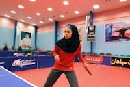 "Neda Shahsavari, Iran's first woman to compete in table tennis at the Olympics, practises in Tehran on July 9.. Shahsavari, says she is ""thrilled"" to be going to the London Games, and dreams of winning a medal for the Islamic republic"