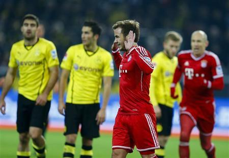 Bayern Munich's Goetze celebrates after he scored a goal against Borussia Dortmund during their German first division Bundesliga soccer match in Dortmund