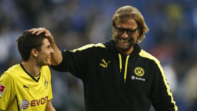 Borussia Dortmund's Hofmann and coach Klopp celebrate their team's 3-1 victory over Schalke 04 following their German first division Bundesliga soccer match at the Schalke Arena in Gelsenkirchen