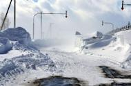 A road in Nakashibetsu town on Hokkaido island is seen covered in snow on March 3, 2013 after severe weekend blizzards sweep northern Japan. At least nine people died in snow-related incidents in Hokkaido over the weekend, including a father who froze to death while sheltering his nine-year-old daughter, reports said Monday