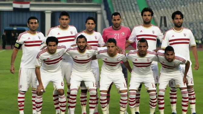 El Zamalek players pose for a photograph before their opening Egyptian Premier League derby soccer match against El Ismaily at Cairo Stadium