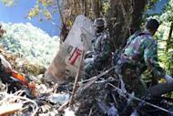 """Indonesian soldiers search the the crash site of the Russian Sukhoi Superjet 100 in Mount Salak located in West Java province, May 12, 2012. Indonesian searchers have found the second """"black box"""" of a new Russian passenger jet three weeks after it crashed into a mountain, killing all 45 aboard, an official said Thursday"""
