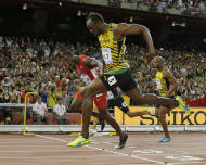 """FILE - In this Aug. 23, 2015, file photo, Jamaica's Usain Bolt crosses the finishing in front of United States' Justin Gatlin, left, to win the men's 100m final at the World Athletics Championships at the Bird's Nest stadium in Beijing. The race that still haunts him? Easy: A premature lean that led to a loss to Bolt in the 100 at the 2015 world championships. On the ride to the hotel, """"I cried every tear I needed to cry from 2006 all the way up to that night,"""" Gatlin said in a new documentary titled, """"Rise Again — The Justin Gatlin Story,"""" an hour-long film produced by Andrew Brereton. (AP Photo/David J. Phillip, File)"""