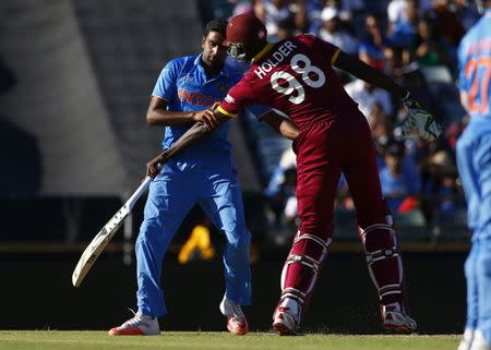 India's bowler Ravichandran Ashwin collides with West Indies captain Jason Holder during their Cricket World Cup match in Perth