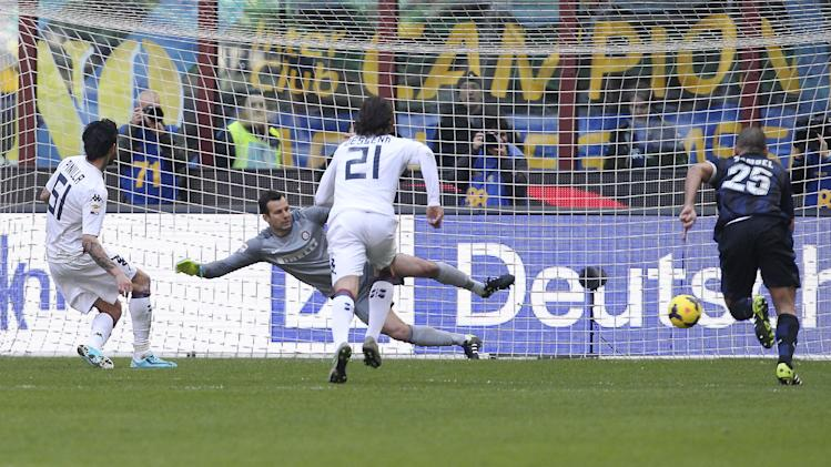 Cagliari forward Mauricio Pinilla, left, of Chile, scores on a penalty kick during the Serie A soccer match between Inter Milan and Cagliari at the San Siro stadium in Milan, Italy, Sunday, Feb. 23, 2014