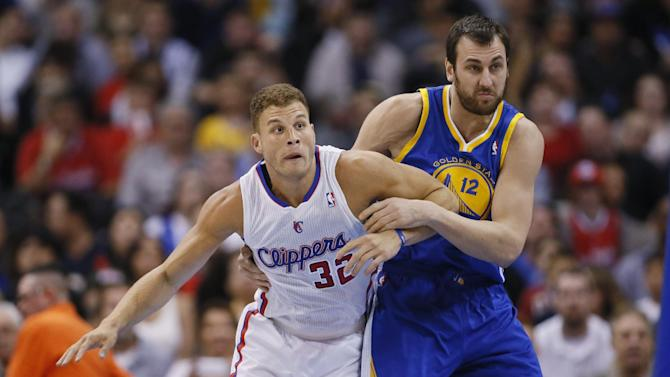 Los Angeles Clippers' Blake Griffin, left, fights for position with Golden State Warriors' Andrew Bogut during the first half of an NBA basketball game in Los Angeles, Wednesday, March 12, 2014