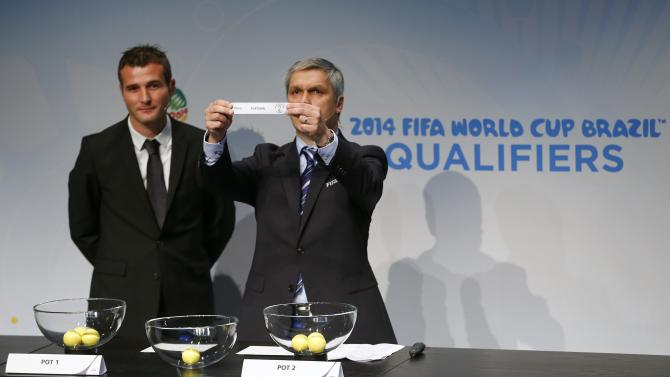 Savic head of FIFA World Cup Qualifiers displays name of Portugal during draw for 2014 World Cup European qualifying playoffs in Zurich